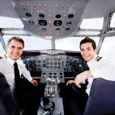 Pilots in an airplane cabin